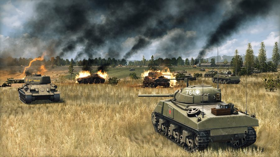 soviet tanks advance past destroyed wrecks