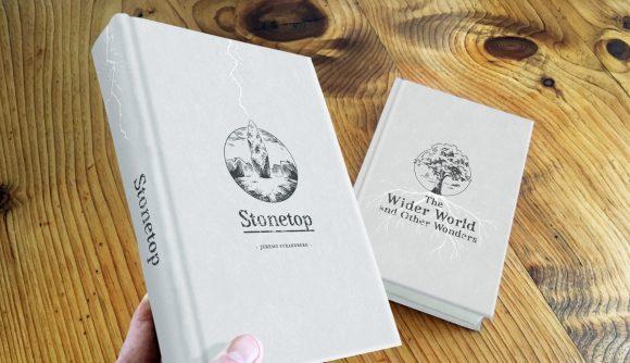 Stonetop tabletop RPG kickstarter photo showing mock up hardback rulebooks