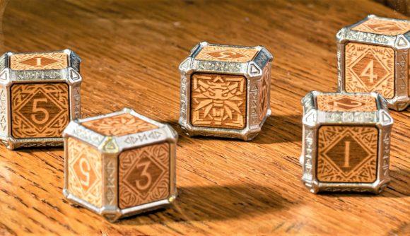 Kickstarter photo of Q workshop metal and wood Witcher hybrid dice