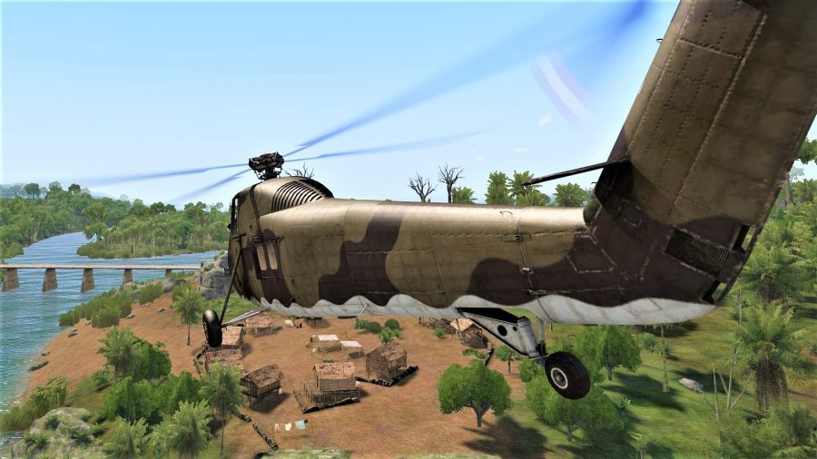 Screenshot from Arma 3 Creator DLC SOG Prairie Fire showing a helicopter flying over a Vietnam village