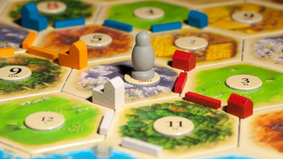 A Robber pawn from a Catan expansion placed on a hex tile