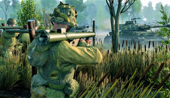 Enlisted screenshot showing USA infantry firing an M1 Bazooka at an enemy tank