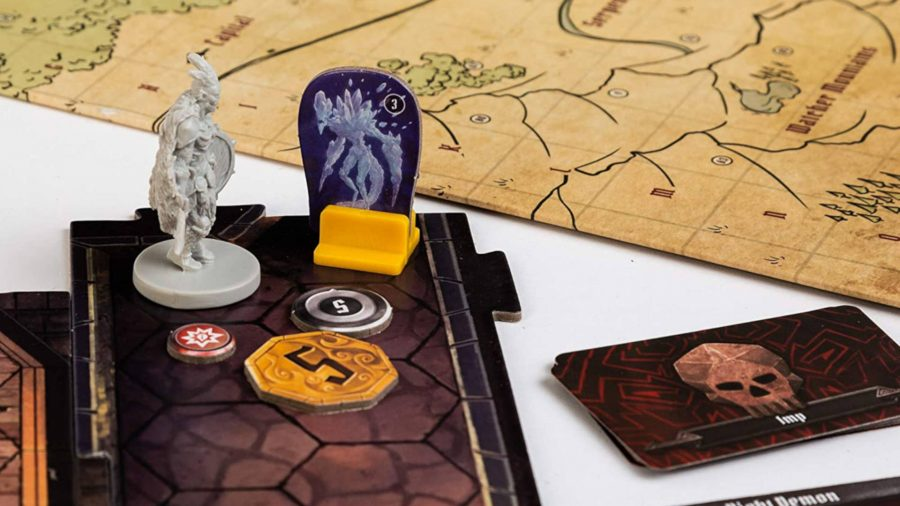 Photo of Gloomhaven board game's map, cards and coins