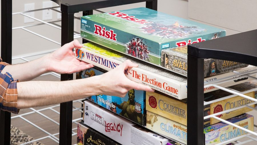 Board games storage a stack of board games on a shelf