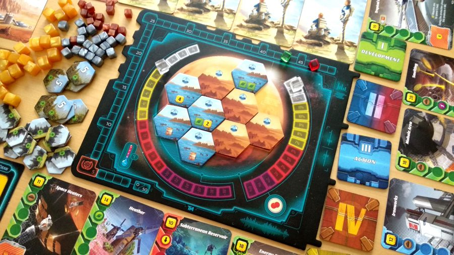 Terraforming Mars: Ares Expedition central board surrounded by cards, tokens, and cubes