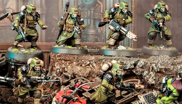 Warhamer 40k Kill Team 2nd edition warhammer community photo showing Krieg Veterans in green charging into Orks