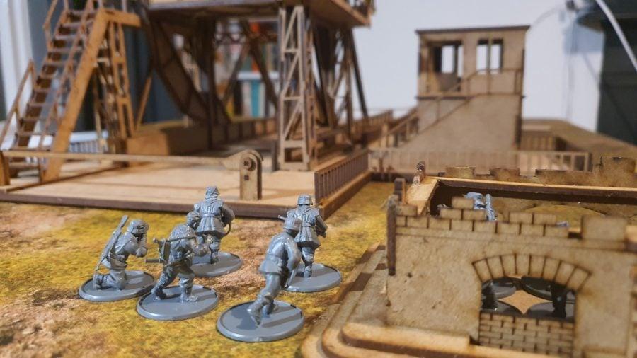 Bolt Action Pegasus Bridge review - photo showing German infantry models facing the bridge