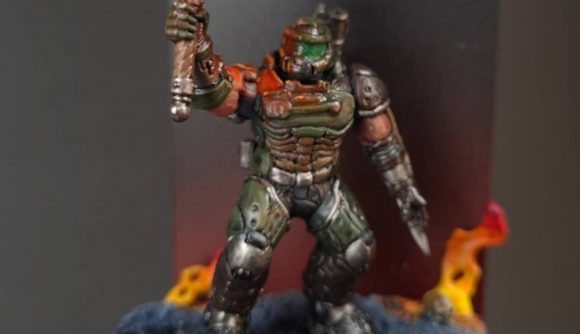 Warhammer 40k Space Marine Doom Slayer converted miniature holding a sword surrounded by flames