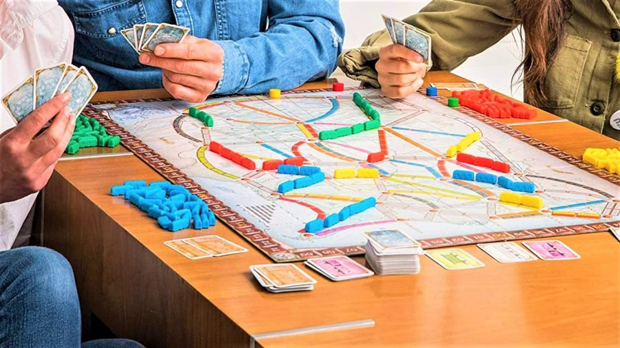 Best board game deals - photo of a family playing the Ticket to Ride board game
