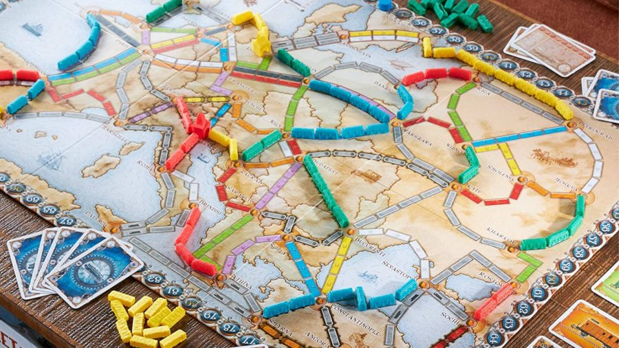 Black Friday board game deals cards and train tokens from Ticket to Ride