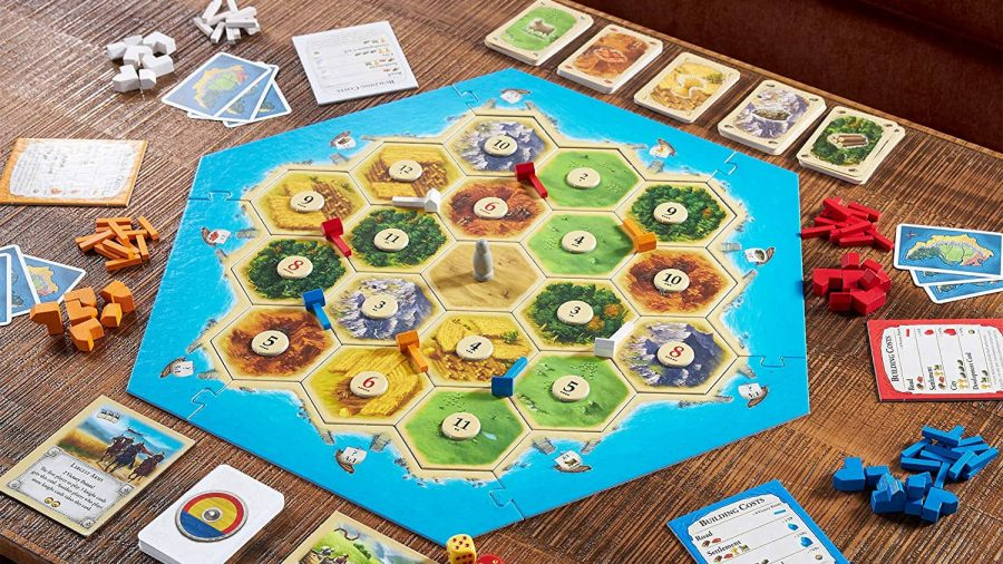 Fun board games Catan board set up on a table, ready to play