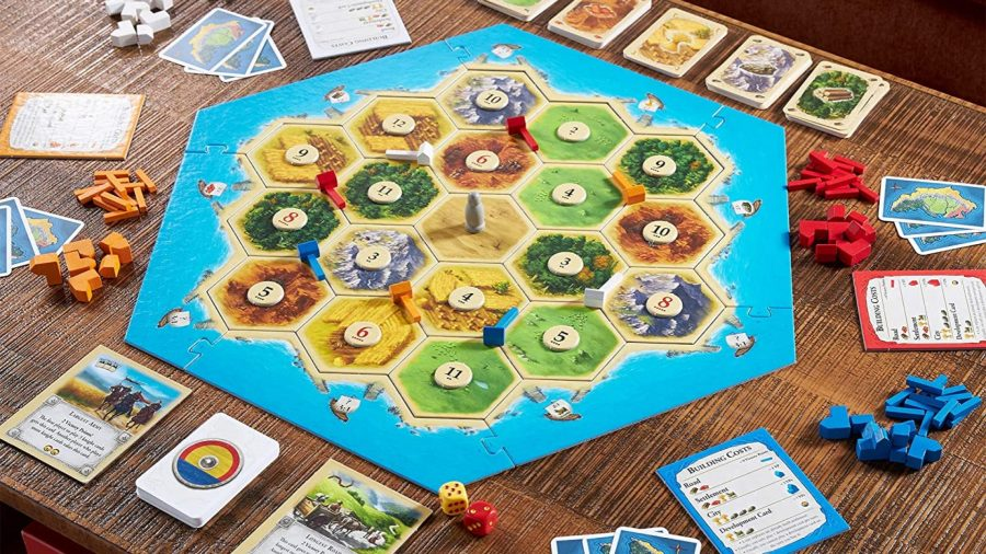 How to play Catan - Official Catan marketing photo showing a six player game fully set up with board, cards, and pieces