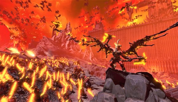 Total War Warhammer 3 release date - Total War Warhammer III screenshot showing an army of Khorne daemons led by a Bloodthirster